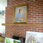 painting of Dr. Annie on fireplace mantel